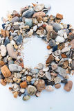 Frame stones. Frame of sea shells with stones Stock Images