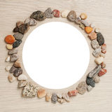 Frame of stones with white circle in the middle on unique backing Royalty Free Stock Photo
