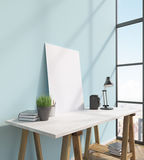 Frame on table. Blank frame on white table, books on and under table, lamp, window to the right, city view. Concept of decoration. Mock up. 3D rendering Royalty Free Stock Image