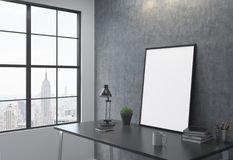 Frame on the table leaning on the wall Stock Photography
