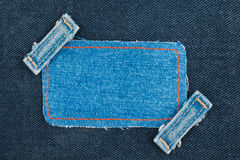 Frame, tag, price  with two straps jeans, lies on the dark denim Stock Photography
