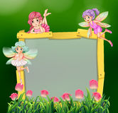 Frame template with three fairies Stock Photos