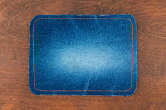 Frame for the text from a blue jeans fabric with the stitched li Royalty Free Stock Images