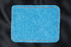Frame for the text from a blue jeans fabric with the stitched lines of an orange thread Royalty Free Stock Photos