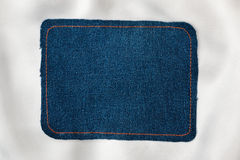 Frame for the text from a blue jeans fabric with the stitched lines of an orange thread Royalty Free Stock Images