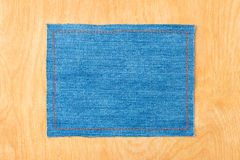 Frame for the text from a blue jeans fabric with the stitched lines of an orange thread Royalty Free Stock Photo