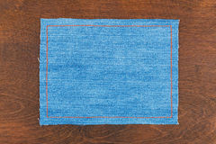 Frame for the text from a blue jeans fabric with the stitched lines of an orange thread Stock Photography