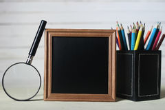 Frame for text books and watch Stock Photos
