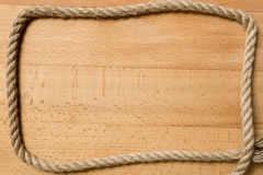 Frame for text from marine rope on wooden boards Stock Photography