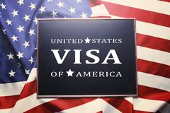 Frame with text VISA UNITED STATES OF AMERICA on USA flag background. Close up of black chalkboard with UNITED STATES OF AMERICA VISA text written on it. Visa Royalty Free Stock Photography