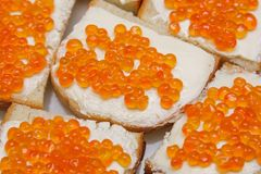 In the frame there are several sandwiches with red caviar, close-up. Top view, horizontal Royalty Free Stock Image