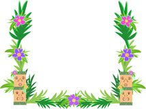 Frame of Tiki and Hibiscus Flowers Royalty Free Stock Photos