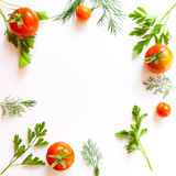 Frame with tomato and herbs Stock Photo