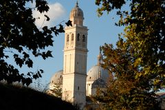 Frame of tree branches to the bell tower and the domes of Santa Giustina in Padua in Veneto (Italy) Royalty Free Stock Image