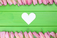 Frame from Tulips flowers with heart on mothers or Valentine's d Stock Images