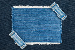 Frame with two straps jeans, lies on the dark denim Royalty Free Stock Images