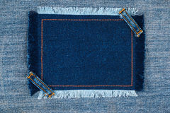 Frame with two straps jeans, lies on the light denim Royalty Free Stock Images