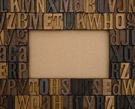 A Frame of Type Set Letters. On a kraft background royalty free stock images