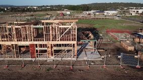 Frame under construction Australian Site. Aerial view of timber frame under construction Australian Site 2 storey home stock video footage