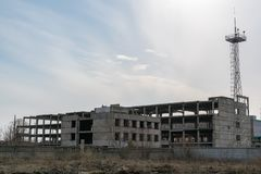 The frame of an unfinished abandoned building, in the open stock images