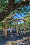 Frame of an unfinished wooden pergola for rest Stock Photography