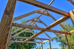 Frame of an unfinished wooden pergola for rest Royalty Free Stock Images