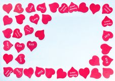 Frame for valentine card with scattered red hearts background white with place for text stock photo
