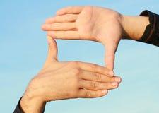 Frame van de handen Stock Foto's