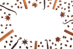 Frame of vanilla sticks, cinnamon, coffee beans and star anise  on white with copy space for your text. Top view Stock Image