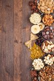 Fruits and Nuts. Frame of variety of fruits and nuts on a dark wooden surface Stock Photos