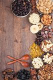 Fruits and Nuts. Frame of variety of fruits and nuts on a dark wooden surface Royalty Free Stock Photos