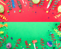 Frame from various celebratory items on colorful background Royalty Free Stock Images