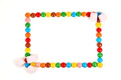 Frame of various colorful candy on white background stock photos