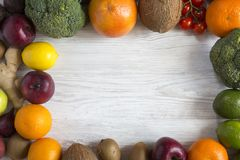 Frame of various fresh organic fruits and vegetables, top view. stock photo