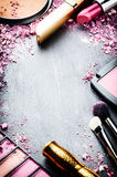 Frame with various makeup products. In pink tone Stock Images