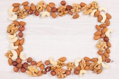 Frame of various nuts and almonds containing healthy natural vitamins and minerals, nutritious eating. Concept royalty free stock images