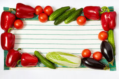 Frame from various vegetables on towel perimeter Stock Photos