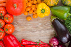 Frame of  vegetables. Blank wooden table  with frame of colorful vegetables Royalty Free Stock Photography