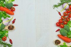 Frame of vegetables. Close-up healthy food composition of organic eating on wooden background. Top view. Selective focus royalty free stock photo