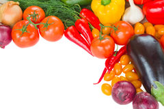 Frame of vegetables. Frame of colorful vegetables - tomatoes, onion, peppers and eggplant royalty free stock photo
