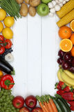 Frame from vegetables and fruits like tomato, apple, orange with Stock Images