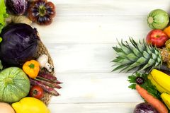 FRAME OF VEGETABLES AND FRUITS ON WHITE WOODEN BACKGROUND. COPY. SPACE, HORIZONTAL HIGH ANGLE VIEW stock image