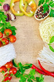 Frame of vegetables and funchozy on sacking Royalty Free Stock Photo