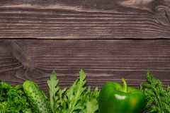Frame of vegetables, herbs on wooden background, top view royalty free stock images