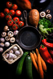 Frame of vegetables with old skillet, healthy or vegetarian concept. Top view, copy space stock photography