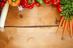 Frame of vegetables. Wooden background royalty free stock images