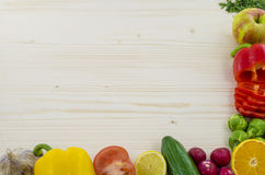 Frame of vegetables on wooden table. Background. Royalty Free Stock Photos