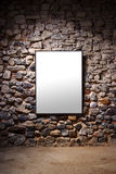 Frame Wall. Empty frame attached to a stone wall in a gallery room Royalty Free Stock Photo