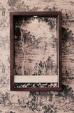 Frame on the wall. A frame is decorated on the A frame is decorated on the Chinese ancient painting background wall Royalty Free Stock Image