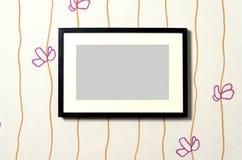 Frame on wallpaper 01. Black frame with passepartout on modern design wallpaper stock illustration